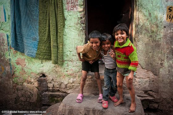 How can slums be improved?